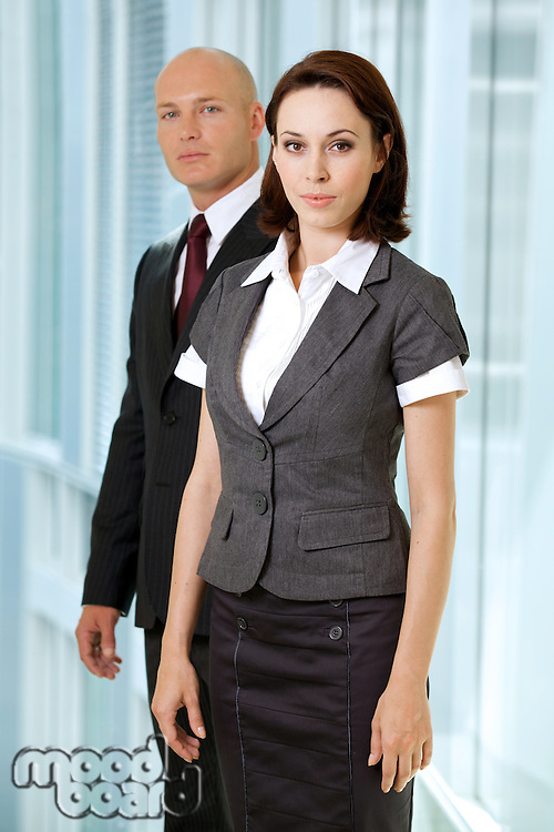 Portrait of young caucasian businessman and businesswoman in off