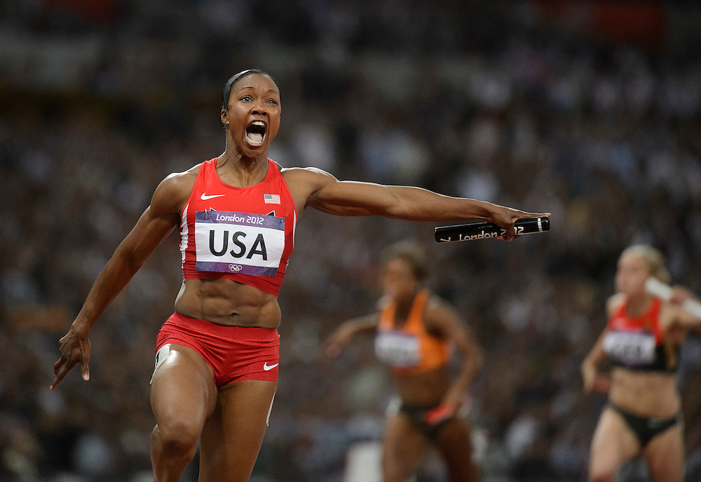 Athletics Day 14: Carmelita Jeter celebrates the USA's women's 4x100 meter relay gold medal victory during the 2012 London Olympic Games, at Olympic Stadium.
