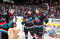 KELOWNA, CANADA - DECEMBER 1: Erik Gardiner #11 and  Ethan Ernst #19 of the Kelowna Rockets pose on the ice during the annual teddy bear toss against the Saskatoon Blades on December 1, 2018 at Prospera Place in Kelowna, British Columbia, Canada.  (Photo by Marissa Baecker/Shoot the Breeze)