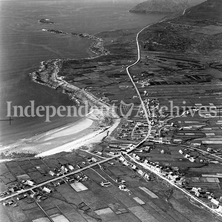 A1 Dooagh Strand, Achill.   25/03/55 (Part of the Independent Newspapers Ireland/NLI collection.)<br /> <br /> <br /> These aerial views of Ireland from the Morgan Collection were taken during the mid-1950's, comprising medium and low altitude black-and-white birds-eye views of places and events, many of which were commissioned by clients. From 1951 to 1958 a different aerial picture was published each Friday in the Irish Independent in a series called, 'Views from the Air'.<br /> The photographer was Alexander 'Monkey' Campbell Morgan (1919-1958). Born in London and part of the Royal Artillery Air Corps, on leaving the army he started Aerophotos in Ireland. He was killed when, on business, his plane crashed flying from Shannon.