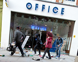 © Licensed to London News Pictures. 09/08/2011. Manchester, UK. Destruction and looting  across the city centre by gangs. Shops are smashed, looted. Photo credit : Joel Goodman/LNP