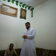 August 24, 2012 - Marea, Aleppo, Syria: Sheik Abu Mariam, commander of the recently created rebel militia Ibnu Walid, meets with some volunteer fighters in the village of Marea. The militia incorporates 25 fighters and has the intent to be an elite group to perform guerrilla style operations against syrian army troops in the province of Aleppo.
