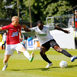 AUGUST 12:  Dover Athletic against Wrexham in Conference Premier at Crabble Stadium in Dover, England. Dover's defender Femi Ilesanmi beats Wrexham's midfielder Marcus Kelly. (Photo by Matt Bristow/mattbristow.net)