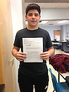 Ricardo Ortiz, Eastwood Academy, shows off his acceptance letter to Youth About Business, 2015.