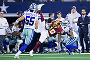 ARLINGTON, TX - NOVEMBER 22:  Josh Doctson #19 of the Washington Redskins catches a pass in front of Byron Jones #31 of the Dallas Cowboys at AT&T Stadium on November 22, 2018 in Arlington, Texas.  The Cowboys defeated the Redskins 31-23.  (Photo by Wesley Hitt/Getty Images) *** Local Caption *** Josh Doctson; Byron Jones