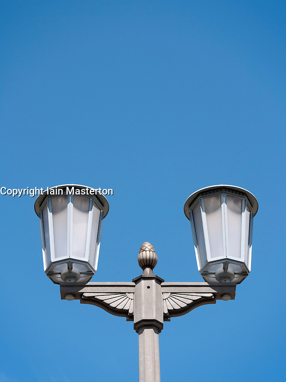 Detail of former East German decorative street light on historic Karl Marx Allee in Berlin Germany
