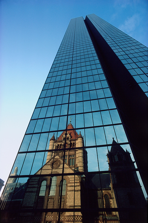 John Hancock Tower with Trinity Church reflection, Boston, Massachusetts, The tower, the tallest in the city, was designed by Henry N. Cobb of Pei Cobb Freed & Partners