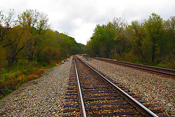 October 2009: Railroad tracks disappear into the colored woods of fall west of Galena. Sights to see in and around Galena Illinois. This image was produced in part utilizing High Dynamic Range (HDR) or panoramic stitching or other computer software manipulation processes. It should not be used editorially without being listed as an illustration or with a disclaimer. It may or may not be an accurate representation of the scene as originally photographed and the finished image is the creation of the photographer.