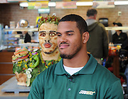Anthony Barr, 2014 draft prospect and newest SUBWAY Famous Fan, smiles next to his life-size food statue made of fresh vegetables, Wednesday, May 7, 2014, in New York. Barr joins a roster of fellow Famous Fans that include Robert Griffin III, Justin Tuck, Russell Westbrook, Pele and Michael Phelps. (Photo by Diane Bondareff/Invision for SUBWAY/AP Images)