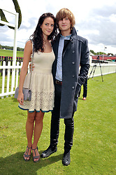 KAYA SCODELARIO and ELLIOT TITTENSOR at the Cartier Queen's Cup Polo Final, Guards Polo Club, Windsor Great Park, Berkshire, on 17th June 2012.
