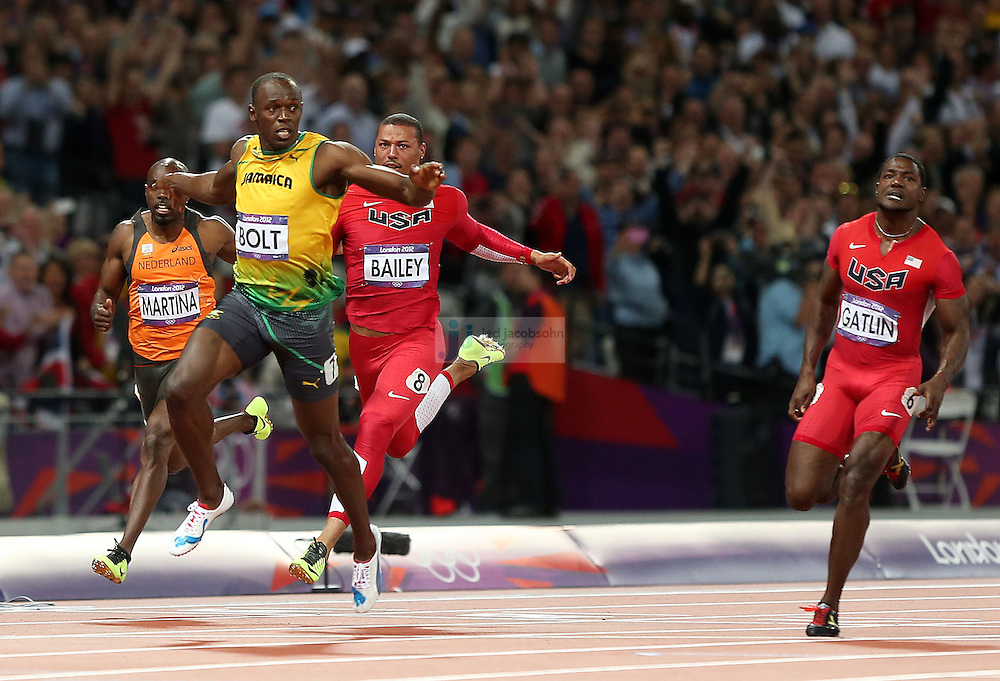 Usain Bolt of Jamaica crosses the finish line to win the gold medal during the 100m final during track and field at the Olympic Stadium during day 9 of the London Olympic Games in London, England, United Kingdom on August 3, 2012..(Jed Jacobsohn/for The New York Times)..