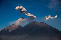 Antigua, Guatemala - March 10, 2015: Steam billows out of Volcán de Fuego, a volcano which is constantly active on a low level basis. Though severe eruptions are rare, as recently as February 8, 2015, an eruption caused the evacuation of 100 residents and the closure of La Aurora International Airport 16 miles away in Guatamala City as a result of the large amounts of falling ash. CREDIT: Chris Carmichael for The New York Times