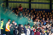 Northampton Town fans let off a smoke bomb during the Sky Bet League 2 match at Kenilworth Road, Luton<br /> Picture by David Horn/Focus Images Ltd +44 7545 970036<br /> 25/10/2014