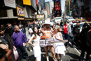 Nude models from PETA (People for the Ethical Treatment of Animals) shower in Times Square to highlight the meat industry's impact on the planet in New York April 21, 2008. Photo by Keith Bedford