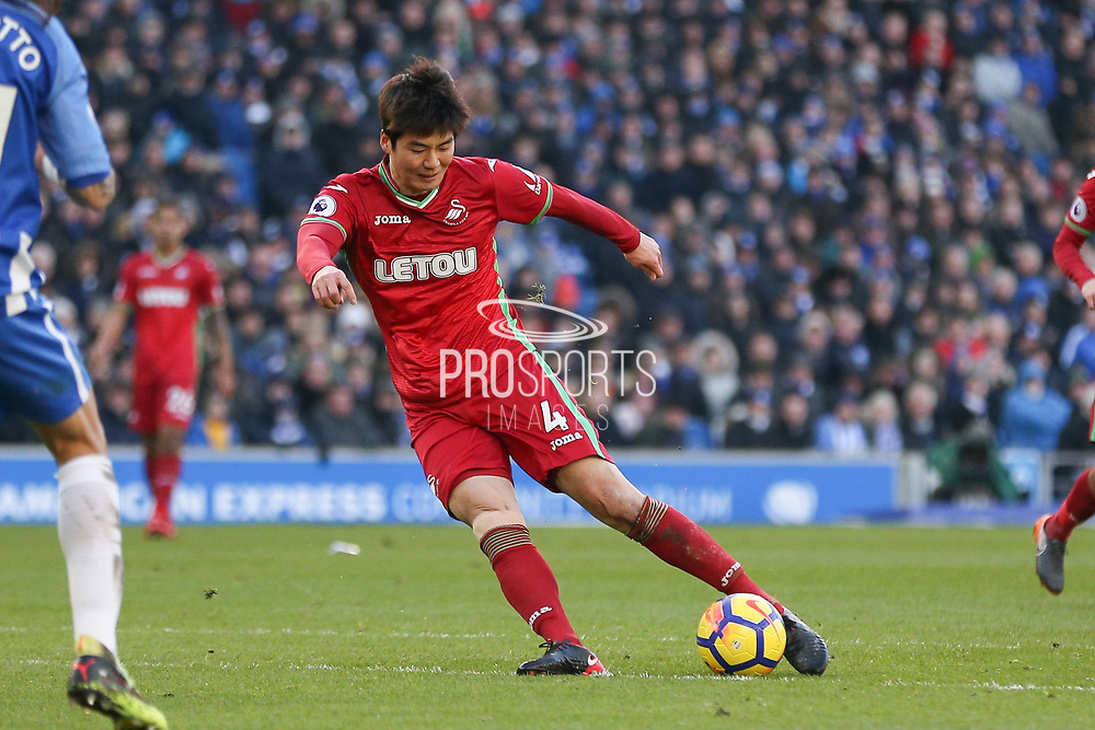 Swansea City midfielder Sung-Yueng Ki (4) shoots at goal during the Premier League match between Brighton and Hove Albion and Swansea City at the American Express Community Stadium, Brighton and Hove, England on 24 February 2018. Picture by Phil Duncan.