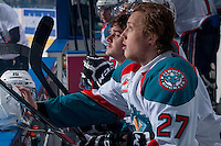 KELOWNA, CANADA - APRIL 25: Ryan Olsen #27 and Kris Schmidli #16 of the Kelowna Rockets sit on the bench against the Portland Winterhawks on April 25, 2014 during Game 5 of the third round of WHL Playoffs at Prospera Place in Kelowna, British Columbia, Canada. The Portland Winterhawks won 7 - 3 and took the Western Conference Championship for the fourth year in a row earning them a place in the WHL final.  (Photo by Marissa Baecker/Getty Images)  *** Local Caption *** Ryan Olsen; Kris Schmidli;