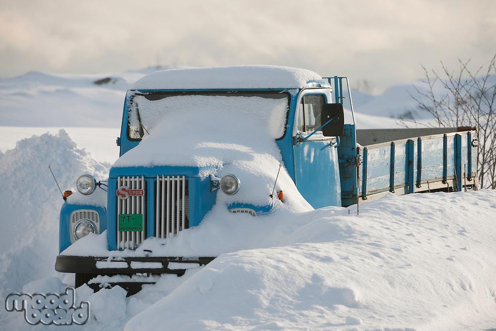 Truck is snowed in Flakstadoya Loftofen Norway
