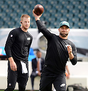 Philadelphia Eagles quarterback Chase Daniels tosses a football as starting quarterback Carson Wentz stands by before the start of the Eagles - Browns football game September 11, 2016 at Lincoln Financial Field in Philadelphia, Pennsylvania.  (Photo by William Thomas Cain)