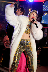 60880147<br /> Miley Cyrus performs live at the New Years Eve celebrations in Times Square, Tuesday, 31st December 2013. Picture by  imago / i-Images<br /> UK ONLY