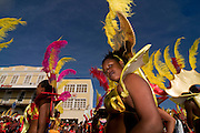 Colourful costumed, pretty women are dancing. Carnival. Mindelo. Cabo Verde. Africa.