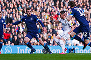 Leeds United midfielder Jack Harrison (22) and Huddersfield Town defender Harry Toffolo (3) in action during the EFL Sky Bet Championship match between Leeds United and Huddersfield Town at Elland Road, Leeds, England on 7 March 2020.