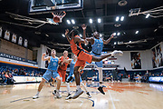 San Diego Toreros forward James Jean-Marie (23) blocks a shot attempt against Cal State Fullerton Titans guard Brandon Kamga (1) during an NCAA basketball game, Wednesday, Dec. 11, 2019, in Fullerton, Calif. San Diego defeated CSUF 66-54. (Jon Endow/Image of Sport)