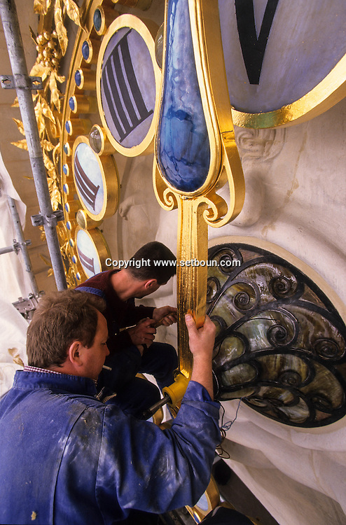 France. Paris. Clock restorers working for Mamias return the restored clock to the Le Monde Building.