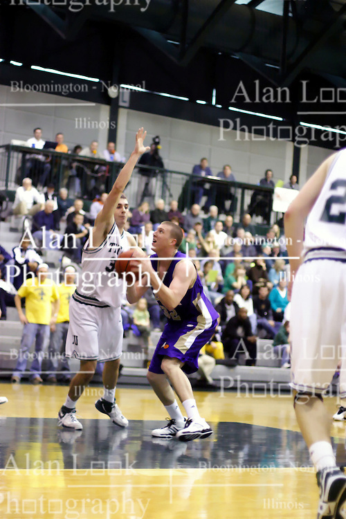 30 December 2006: Zach Freeman comes from the side to block a shot by Andrew Holms. The Titans outscored the Britons by a score of 94-80. The Britons of Albion College visited the Illinois Wesleyan Titans at the Shirk Center in Bloomington Illinois.<br />