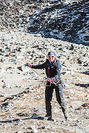 Katie practices abseiling (rappelling), at Island Peak Base Camp.