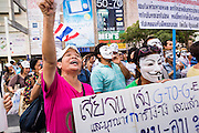 "09 JUNE 2013 - BANGKOK, THAILAND:   Anti-government protester on the plaza in front of Central World in Bangkok. The White Mask protesters wear the Guy Fawkes mask popularized by the movie ""V for Vendetta"" and the protest groups Anonymous and Occupy. Several hundred members of the White Mask movement gathered on the plaza in front of Central World, a large shopping complex at the Ratchaprasong Intersection in Bangkok, to protest against the government of Thai Prime Minister Yingluck Shinawatra. They say that her government is corrupt and is a ""puppet"" of ousted (and exiled) former PM Thaksin Shinawatra. Thaksin is Yingluck's brother. She was elected in 2011 when her brother endorsed her.   PHOTO BY JACK KURTZ"