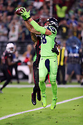 Seattle Seahawks tight end Jimmy Graham (88) is covered tightly by Arizona Cardinals strong safety Tyvon Branch (27) as he leaps and catches a 6 yard touchdown pass good for a 7-0 first quarter Seahawks lead during the 2017 NFL week 10 regular season football game against the Arizona Cardinals, Thursday, Nov. 9, 2017 in Glendale, Ariz. The Seahawks won the game 22-16. (©Paul Anthony Spinelli)