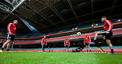 CARDIFF, WALES - Saturday, March 26, 2016: Wales' Sam Vokes, David Cotterill, Joe Allen, James Chester and Neil Taylor during a training session at the Millennium Stadium ahead of the International Friendly match against Ukraine. (Pic by David Rawcliffe/Propaganda)