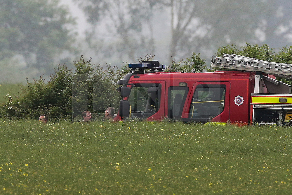 © Licensed to London News Pictures. 30/05/2018. Aldborough, UK. Emergency services attend the scene of a helicopter crash near the village of Aldborough in North Yorkshire. Photo credit: Nigel Roddis/LNP