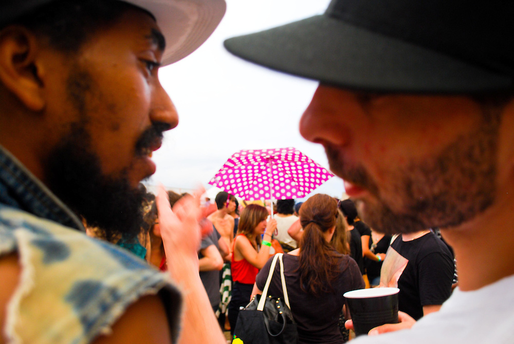 Ninjasonik, left, in conversation at the JELLY Pool Party free concert series at East River State Park, Williamsburg, Brooklyn, New York