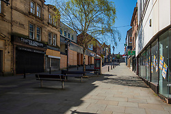 20 April 2020 Rotherham South Yorkshire - Week 5 of the UK emergency measures to combat the Coronavirus Covid-19 Pandemic. High Street looking towards the Corn Law<br /> <br /> 20 April 2020<br /> <br /> www.pauldaviddrabble.co.uk<br /> All Images Copyright Paul David Drabble - <br /> All rights Reserved - <br /> Moral Rights Asserted -