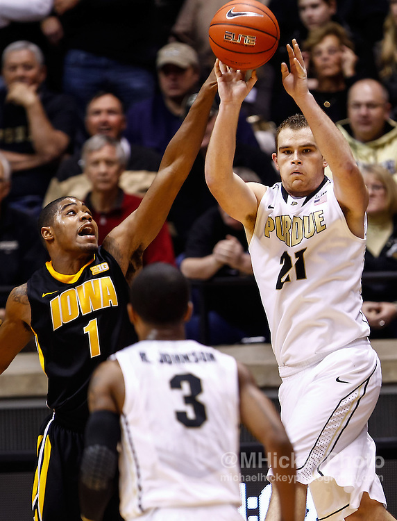 WEST LAFAYETTE, IN - JANUARY 27: As Melsahn Basabe #1 of the Iowa Hawkeyes defends D.J. Byrd #21 of the Purdue Boilermakers passes the ball off at Mackey Arena on January 27, 2013 in West Lafayette, Indiana. Purdue defeated Iowa 65-62 in overtime. (Photo by Michael Hickey/Getty Images) *** Local Caption *** Melsahn Basabe; D.J. Byrd