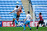 Coventry City forward Kwame Thomas (14) catches Bradford City defender Anthony McMahon (29) in the face  during the EFL Sky Bet League 1 match between Coventry City and Bradford City at the Ricoh Arena, Coventry, England on 11 March 2017. Photo by Simon Davies.
