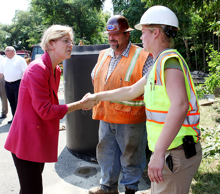 (080212  Framingham, MA) Senatorial candidate Elizabeth Warren greets P. Gioioso & Sons owner Gino Gioioso and engineer Valerie Doerrer at the site of the  East Framingham Sewer Improvements Project, Thursday,  August 02, 2012.  Staff photo by Angela Rowlings.