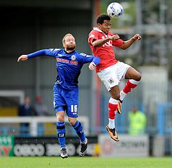 Bristol City's Korey Smith heads the ball under pressure from Rochdale's Matt Done - Photo mandatory by-line: Dougie Allward/JMP - Mobile: 07966 386802 23/08/2014 - SPORT - FOOTBALL - Manchester - Spotland Stadium - Rochdale AFC v Bristol City - Sky Bet League One