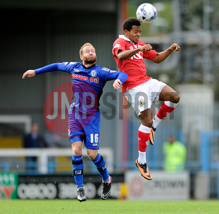Bristol City's Korey Smith heads the ball under pressure from Rochdale's Matt Done - Photo mandatory by-line: Dougie Allward/JMP - Mobile: 07966 386802 23/08/2014 - SPORT - FOOTBALL - Manchester - Spotland Stadium - Rochdale AFC v Bristol City - Sky Bet League One