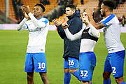 Portsmouth forward Jamal Lowe (10), Portsmouth midfielder Gareth Evans (26), Portsmouth midfielder Ben Thompson (32) and Portsmouth defender Anton Walkes (2) clap the fans after the The FA Cup 3rd round match between Norwich City and Portsmouth at Carrow Road, Norwich, England on 5 January 2019.