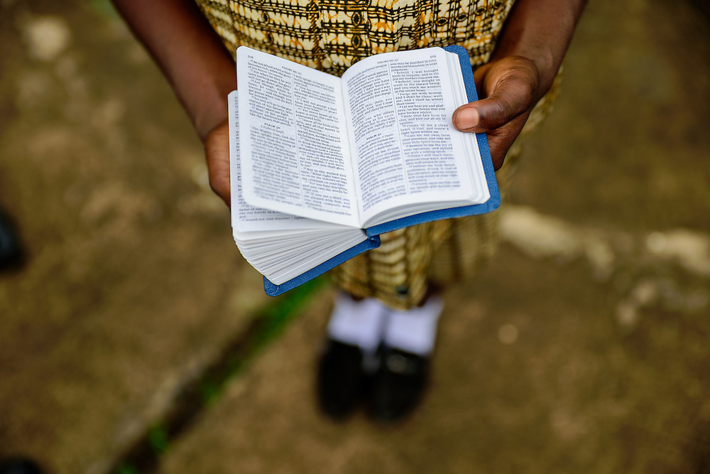 Girl reading a bible on Sunday morning, Tema, Ghana.