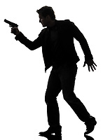 one man killer policeman holding gun walking silhouette studio white background