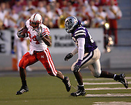 Nebraska running back Cody Glenn (34) scrambles up field for a first down past Kansas State linebacker Reggie Walker (53) at Bill Snyder Family Stadium in Manhattan, Kansas, October 14, 2006.  The Huskers beat the Wildcats 21-3.<br />