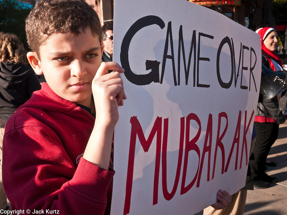 31 JANUARY 2011 - TEMPE, AZ: OMAR HASSAN, 12, demonstrates in Tempe, AZ, in support of democracy in Egypt, Monday. About 200 people marched through central Tempe, AZ, near the Arizona State University campus Monday afternoon. The rally was organized by the Arab American Association of Arizona in solidarity with the ongoing pro-democracy rallies and demonstrations in Egypt and other Arab countries.    Photo by Jack Kurtz