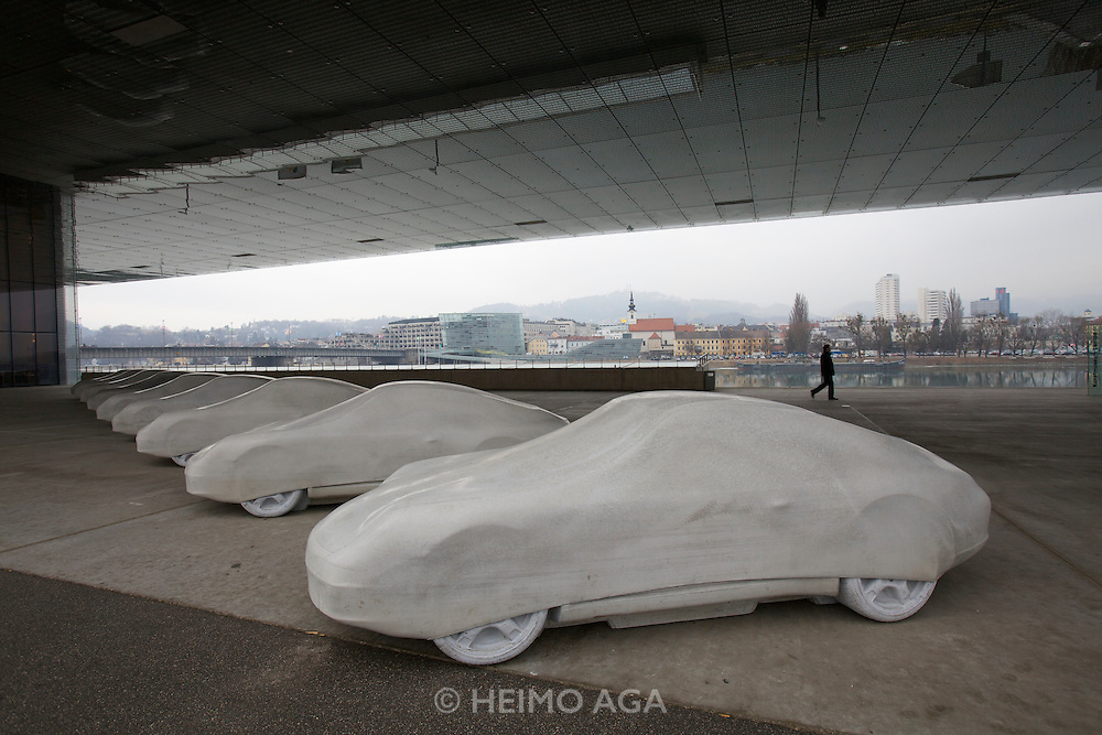 """Linz, Cultural Capital of Europe 2009. Lentos Kunstmuseum. Exhibition """"Best of Austria"""". """"Elf/Elf? by Gottfried Bechtold (eleven concrete Porsches), loan from the collection of Kunsthaus Bregenz."""