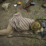 Sean Pridgeon, of Baltimore, gets a quick nap in, before educating visitors as a living historian at a Confederate encampment, during the Sesquicentennial Anniversary of the Battle of Gettysburg, Pennsylvania on Wednesday, July 3, 2013.  The Battle of Gettysburg lasted from July 1-3, 1863 resulting in over 50,000 soldiers killed, wounded or missing.  John Boal Photography