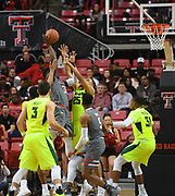 LUBBOCK, TX - DECEMBER 29: Norense Odiase #32 of the Texas Tech Red Raiders shoots the ball over Tristan Clark #25 of the Baylor Bears during the game on December 29, 2017 at United Supermarket Arena in Lubbock, Texas. Texas Tech defeated Baylor 77-53. (Photo by John Weast/Getty Images) *** Local Caption *** Norense Odiase;Tristan Clark