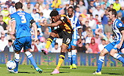 Hull City striker Chuba Akpom shoots for goal under pressure from Brighton captain and central defender, Gordon Greer during the Sky Bet Championship match between Brighton and Hove Albion and Hull City at the American Express Community Stadium, Brighton and Hove, England on 12 September 2015. Photo by Bennett Dean.