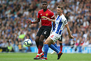 Brighton and Hove Albion midfielder Dale Stephens (6) battles with Manchester United Midfielder Paul Pogba during the Premier League match between Brighton and Hove Albion and Manchester United at the American Express Community Stadium, Brighton and Hove, England on 19 August 2018.